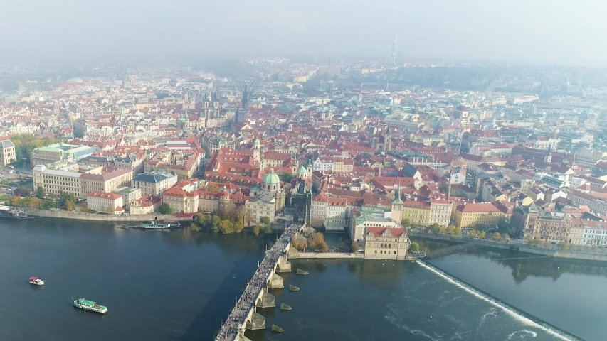 Flight over the vlatva river in Prague, panoramic view of Prague from the air | Shutterstock HD Video #1037340851