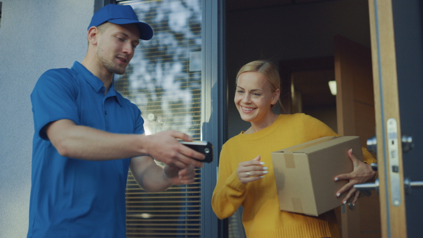 Beautiful Young Woman Opens Doors of Her House and Meets Delivery Man who Gives Her Cardboard Box Postal Package, She Signs Electronic Signature POD Device. Slow Motion
