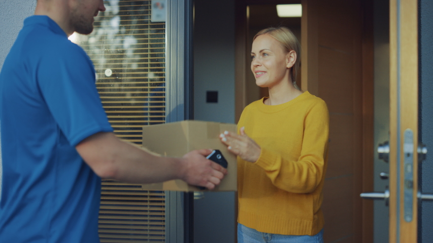 Beautiful Young Woman Opens Doors of Her House and Meets Delivery Man who Gives Her Cardboard Box Postal Package, She Signs Electronic Signature POD Device.