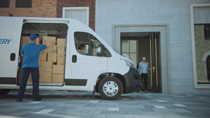 Courier Gets out of Delivery Truck, Takes out Postal Package and Man Gives it to a Customer, Who Signs Electronic Signature POD Device. In Business District Courier Delivers Cardboard Box Parcel