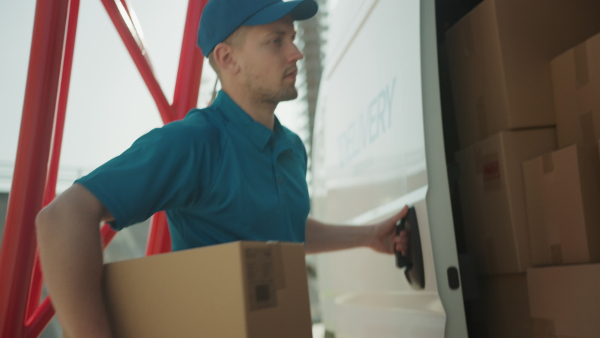 Courier Opens Delivery Van Side Door and Takes out Cardboard Box Package, Closes the Door and Goes on Delivering Postal Parcel. Slow Motion Royalty-Free Stock Footage #1037351351