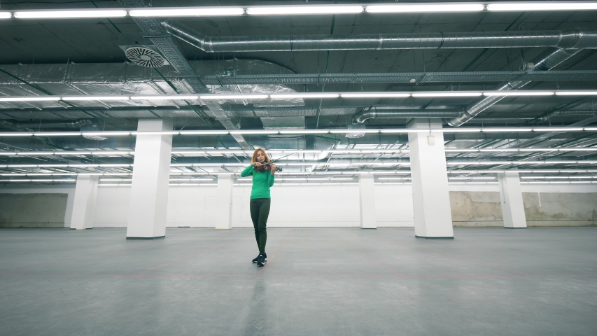 Violin player performs in empty office room. | Shutterstock HD Video #1037355056