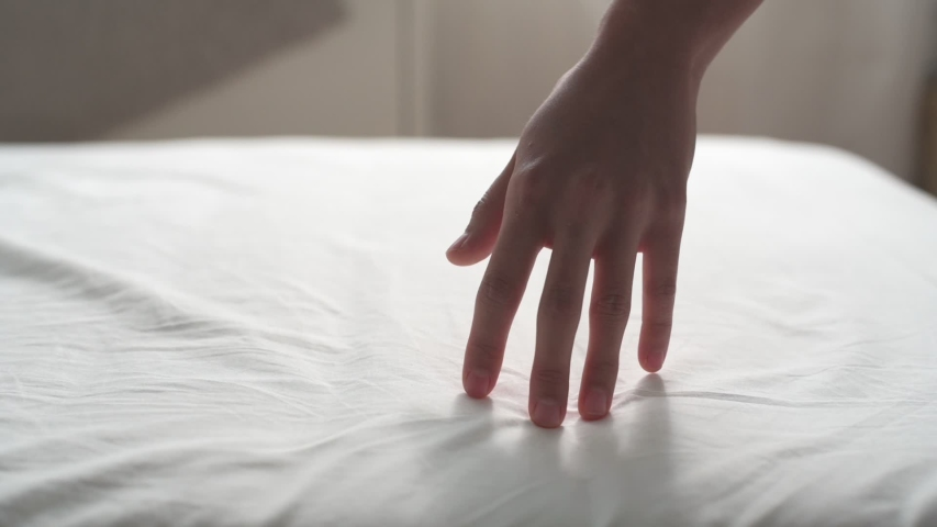 Slow motion follow close up shot of woman dragging her hand on clean white bed gently. Can use for comfort, soft, relax concept. | Shutterstock HD Video #1037365403