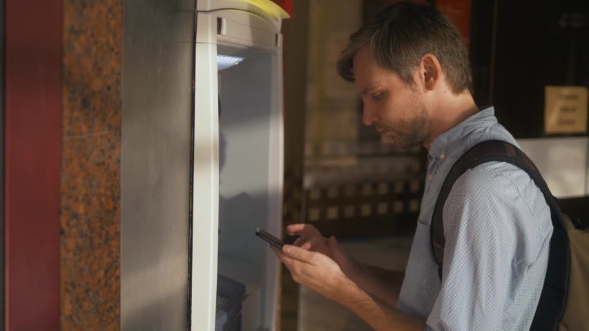 Man using his credit card in an atm for cash withdrawal, pin code money shopping mall or city street europe. Man using his credit card in an atm for cash Royalty-Free Stock Footage #1037365904
