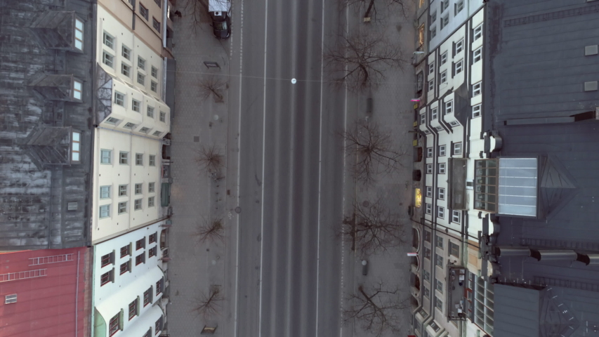Empty street in Stockholm city, Sweden aerial top down view. Quarantined city, empty abandoned streets during corona virus outbreak. Drone shot flying over buildings and street