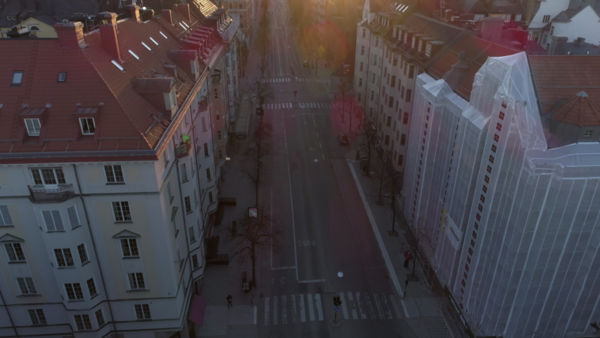 Empty street in Stockholm city, Sweden aerial top down view. Quarantined city, empty abandoned streets during corona virus outbreak. Drone shot flying over buildings and street Royalty-Free Stock Footage #1037367998