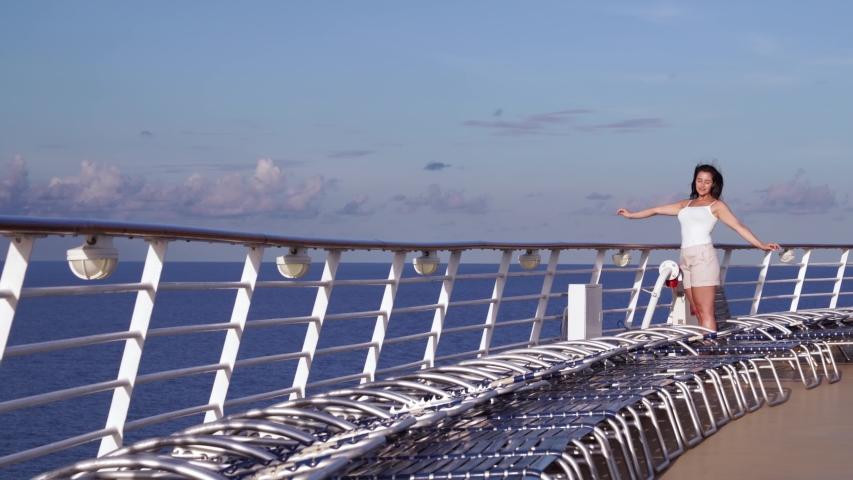 Woman enjoys sunset on a cruise ship  | Shutterstock HD Video #1037383259
