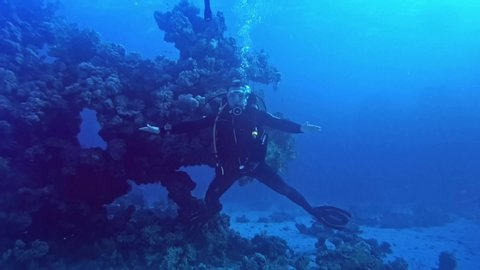 St. Johnes / Egypt - 12 11 2018: Diver taking break in X pose,