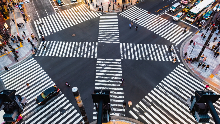 Time lapse People passing the street crossing in Ginza district, Tokyo. Crosswalk. Intersection in Tokyo,Japan