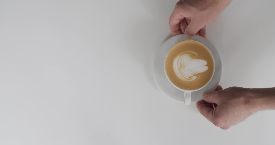 Top view of faceless waiter serving cappuccino to woman inside cafe natural light. Male hands putting white cup with coffee on table and girl taking it slow motion. Restaurant  street food lifestyle  | Shutterstock HD Video #1037392952