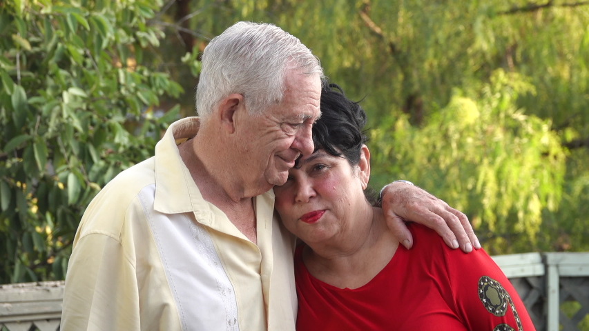 Senior married couple (80 year old Caucasian man and 62 year old Hispanic woman) being close with each other, hugging Royalty-Free Stock Footage #1037422985