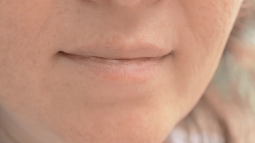 Woman mouth close up. Eating unhealthy food outside in a park. Fingers bring sweet popcorn to your mouth. | Shutterstock HD Video #1037428166