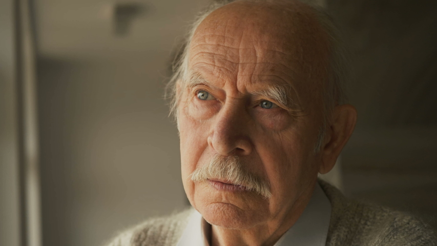 Elderly senior man stay at home on quarantine. Pensive looking away and feel upset. Sad grandfather widower alone. Thoughtful melancholy older retired gray haired grandpa. Sorrow grief loneliness conc | Shutterstock HD Video #1037442647