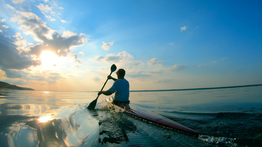 Male rower is ploughing through water | Shutterstock HD Video #1037454155