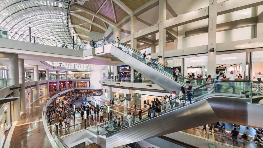 Singapore, Singapore city, 06-15-2019, TL/ZI/PD time lapse of people inside the Marina Bay Sands Shoppers shopping mall, showing the modern interior design, with people using lifts and escalators