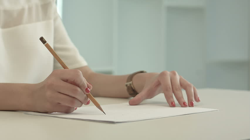 Woman with Pencil Writing On Stock Footage Video (100% Royalty-free)  10374875 | Shutterstock