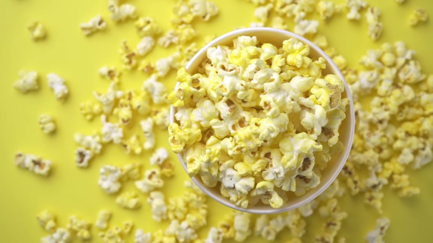 Top down close up slow motion view of popcorn in a container. | Shutterstock HD Video #1037505722
