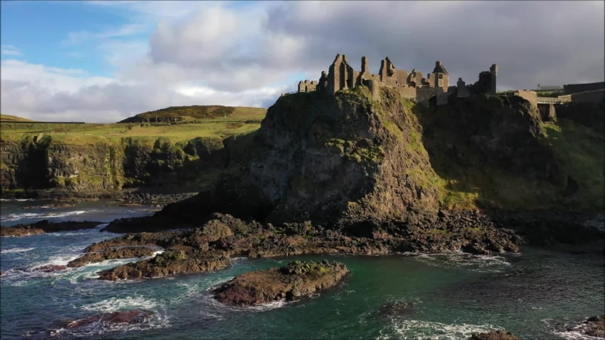Infamous Dunluce Castle on the Co. Antrim coast of N. Ireland and surrounding coastline captured by drone. | Shutterstock HD Video #1037528948