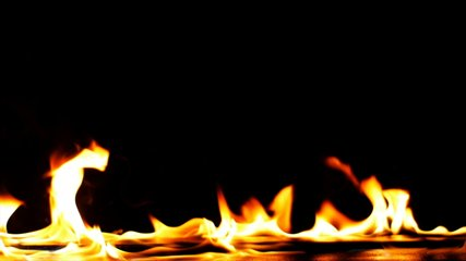 Fire Flames Igniting And Burning - Slow Motion. A line of real flames ignite on a black background. Real fire. Realistic Video Background ... You can use blending mode (screen).