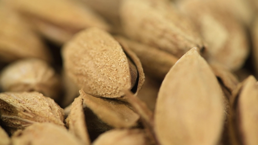 Portion of shelled, roasted Almonds (seamless loopable, 4K) | Shutterstock HD Video #1037564564