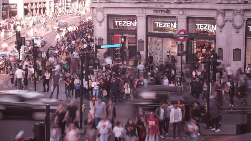 LONDON- SEPTEMBER, 2019: Time lapse of crowds of people and traffic on Oxford Circus, a London landmark and famous shopping destination