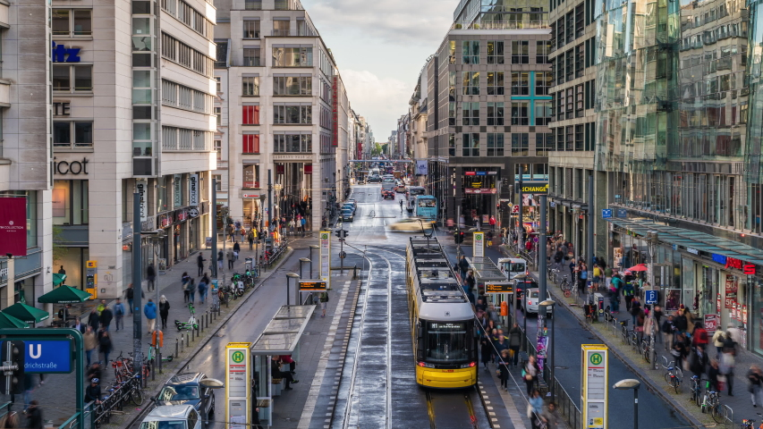 Berlin, Germany - September 22, 2019: Time lapse view of pedestrians, trams and traffic on famous Friedrichstrasse street in Central Berlin by day during fall season.