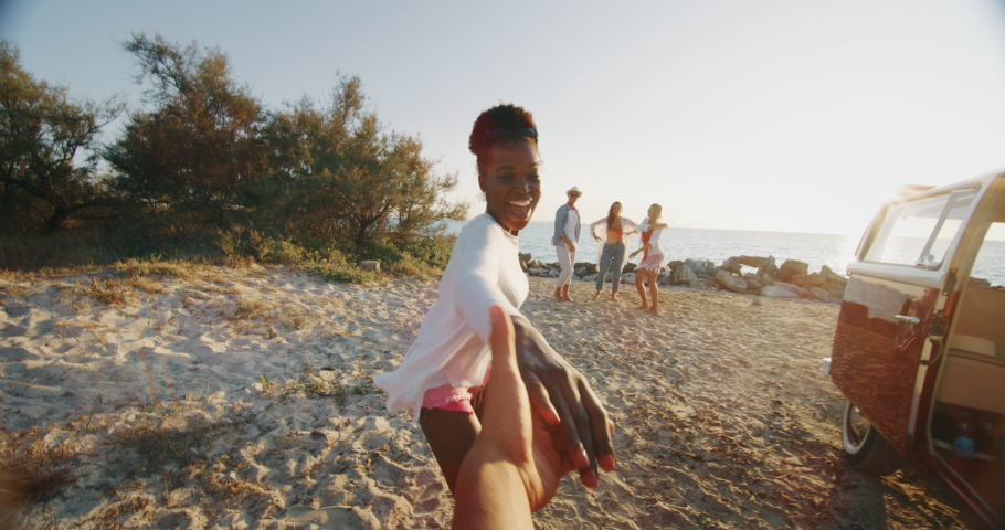 Slow motion of group of young multi-ethnic friends just arrived with a minivan are having fun to start a vacation on a beach with a sea on a sunset. | Shutterstock HD Video #1037631296