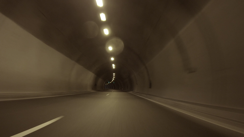 POV, Driving Plate - car driving through a tunnel with bright daylight at the end of it. | Shutterstock HD Video #1037635661