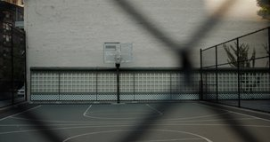 HANDHELD View of an outdoor public basketball court in New York, USA. No people. 4K RAW graded footage