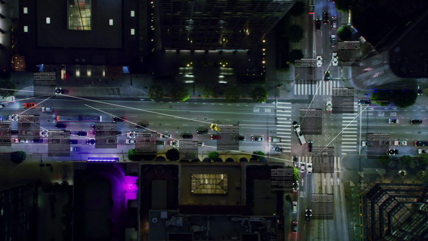 Surveillance system. Aerial view of a crowded downtown avenue. Text and connections displaying in several cars and trucks.  Future transportation. Internet of things. Artificial intelligence. #1037664074