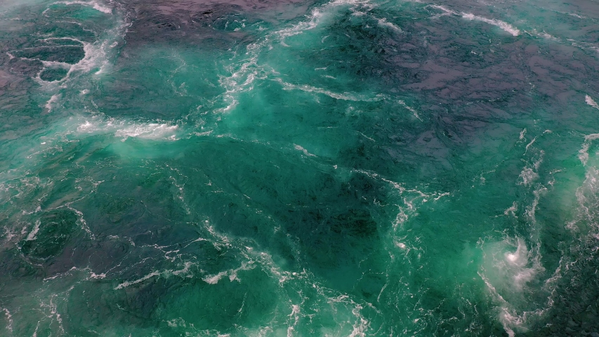 Waves of water of the river and the sea meet each other during high tide and low tide. Whirlpools of the maelstrom of Saltstraumen, Nordland, Norway Royalty-Free Stock Footage #1037708459