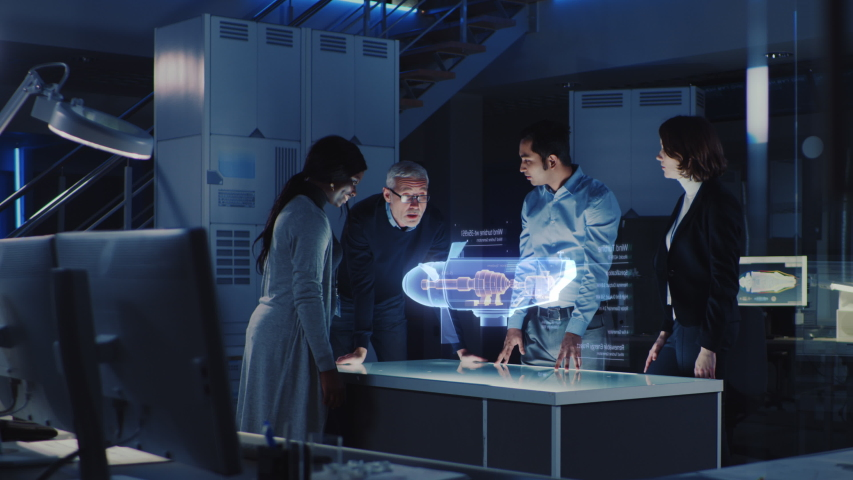 Group of Civil Engineers Work with Holographic Augmented Reality 3D Wind Turbine Model. Technologically Advanced Office Professional People Use Virtual Reality Modeling Software Application. | Shutterstock HD Video #1037713637