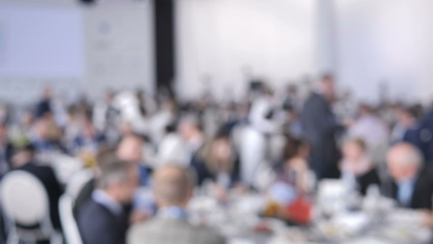Blurred Background Catering Service Waiter Put Plates with Dishes on the Guests Table at a Wedding or Conference. | Shutterstock HD Video #1037723612