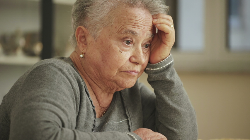 Portrait of thoughtful old woman held her head with her hand.Worries,old age,loneliness | Shutterstock HD Video #1037728373