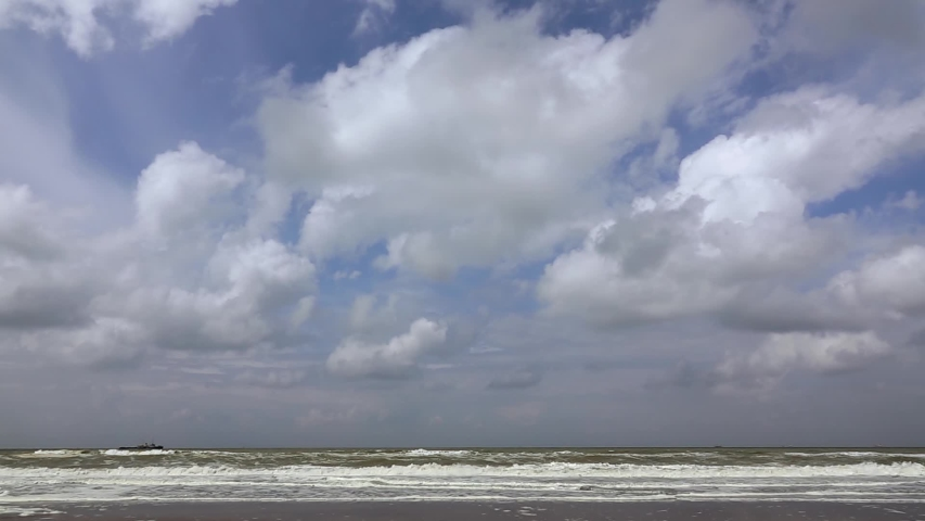 Water at the beach of scheveningen with cloudy skies. Breathtaking natural wonder. Slow Motion. Close up. Copy space