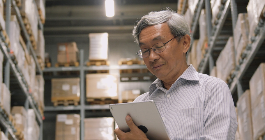 Businessman using tablet for working at warehouse. Business and Technology concept. Royalty-Free Stock Footage #1037770877