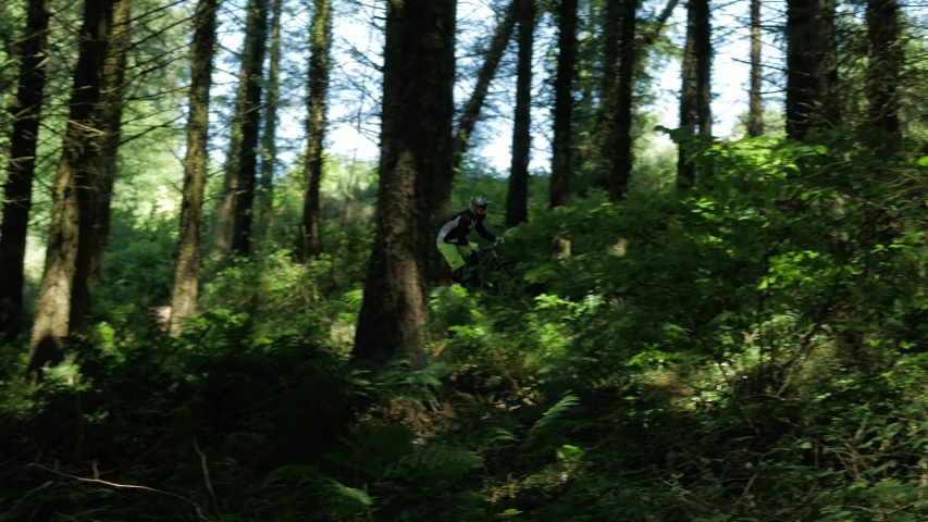 Barnstaple / United Kingdom (UK) - 05 20 2019: Mountain Biking Mtb Cyclist rides sharp turns and hills in the woods to win the MTB competition.