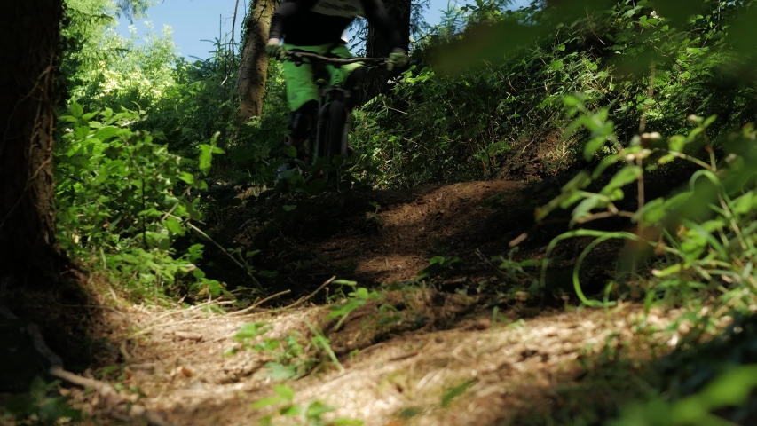Barnstaple / United Kingdom (UK) - 05 20 2019: Mountain Biking Mtb Cyclist Man Rides On Bike Jumps Over Hill In Fore