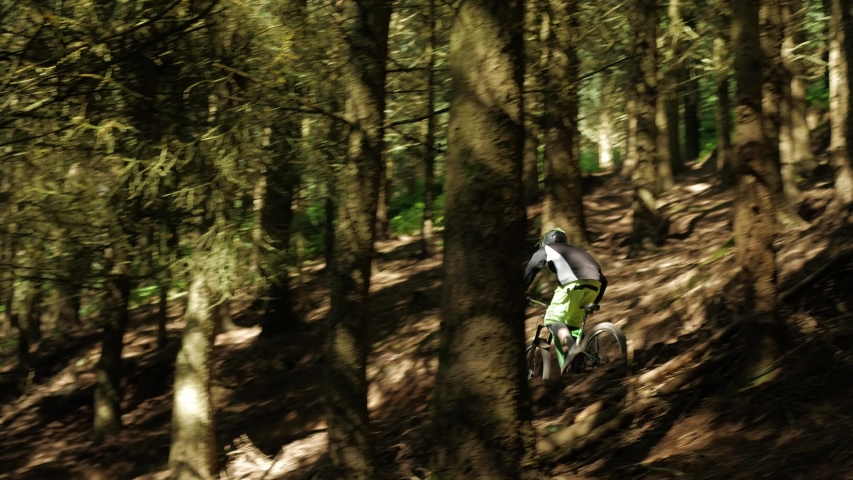 Barnstaple / United Kingdom (UK) - 05 20 2019: Mountain biker biking on MTB bike trail. Man cycling down the forest and enjoying recreational sports activity.