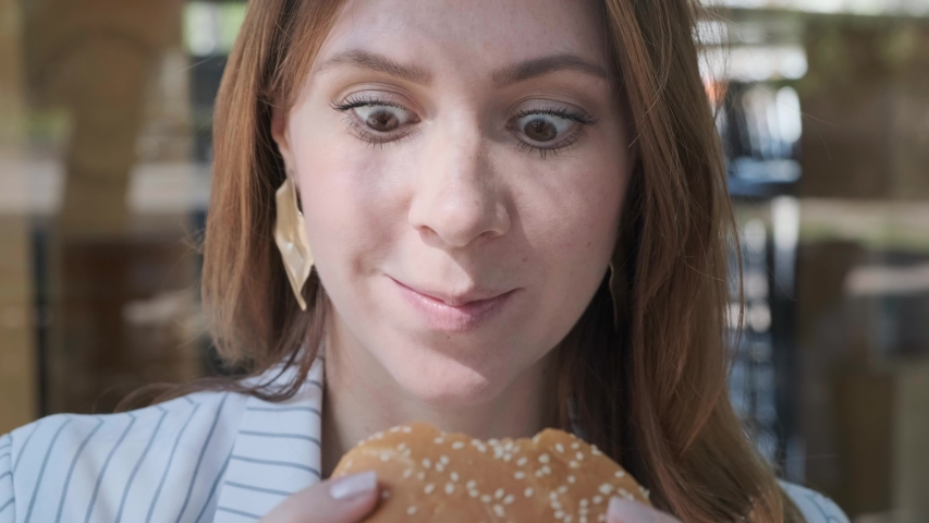 Close up Funny face woman eating vegetarian burger. Pleasure. Healthy eating. Funny emotions slow motion 4k video.