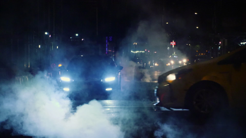New York City Steam At Night - Extreme Slow Motion Cars Driving Through Smoke | Shutterstock HD Video #1037795681