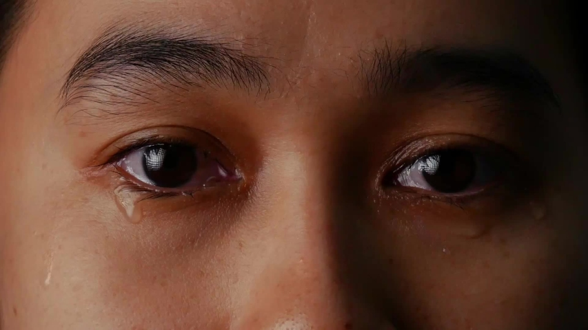 Close up eyes of woman crying with tear on black background. | Shutterstock HD Video #1037832107
