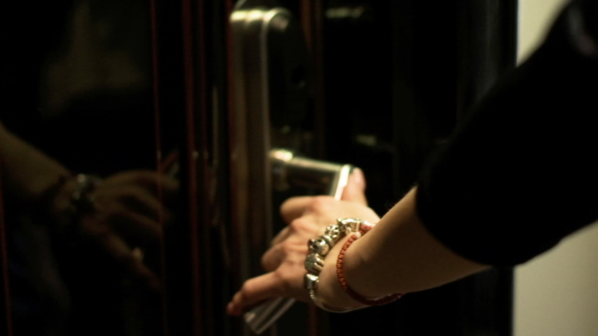 Sensual Female Hand Opens Door to Luxury Apartment Or Hotel Room. Woman Slowly Walking Inside.