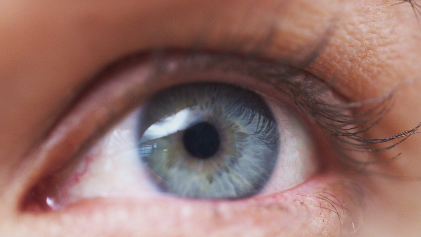 Extreme Close Up Of Eye Opening As woman Looks At Camera In Studio   Shutterstock HD Video #1037854160