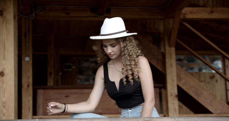Girl in white hat cowboy style #1037871422