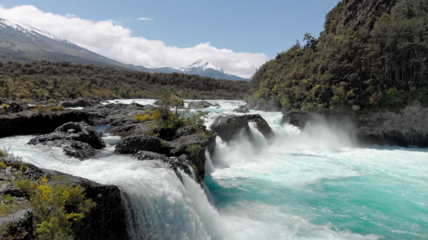 Forest, rapids and volcano Osorno, Patagonia landscape of Saltos de Petrohue, the region of Los Lagos, Chile. 4k | Shutterstock HD Video #1037883236