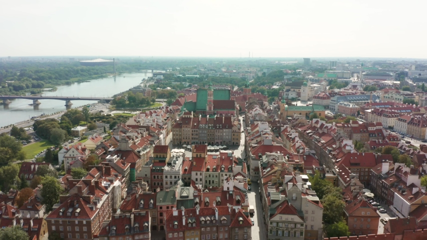 Aerial view of old buildings, castles and a church in the old city of Warsaw. Poland. Flight of the drone over the old city on a sunny summer day.