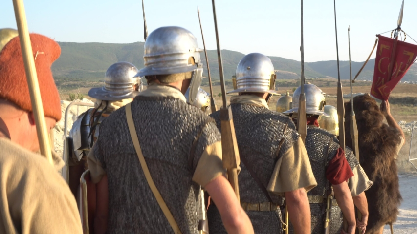 A Roman legion was a large military unit of the Roman army. Ancient Roman military clothing. The Roman Legions Marching to a Historical Battle | Shutterstock HD Video #1037903252