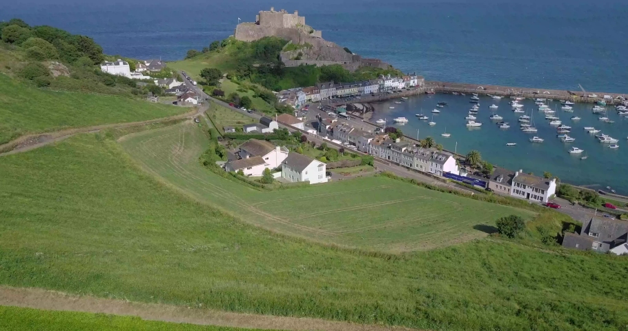 Aerial drone video footage towards Mont Orgueil Castle, Gorey Castle, Jersey, British Isles | Shutterstock HD Video #1037909054