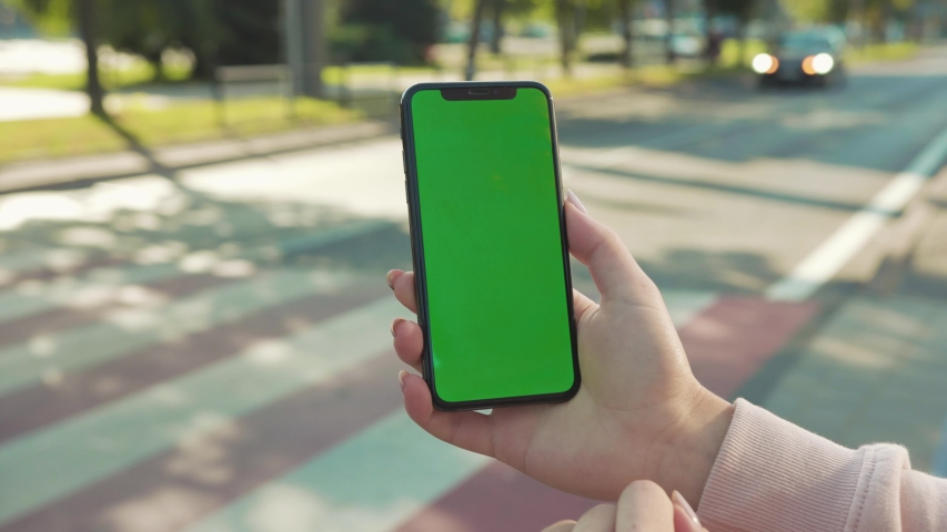 NEW YORK - April 5, 2018: Close up of woman hands holding and touching phone with green screen vertically in the street on background crosswalk car internet technology business message slow motion | Shutterstock HD Video #1037921459